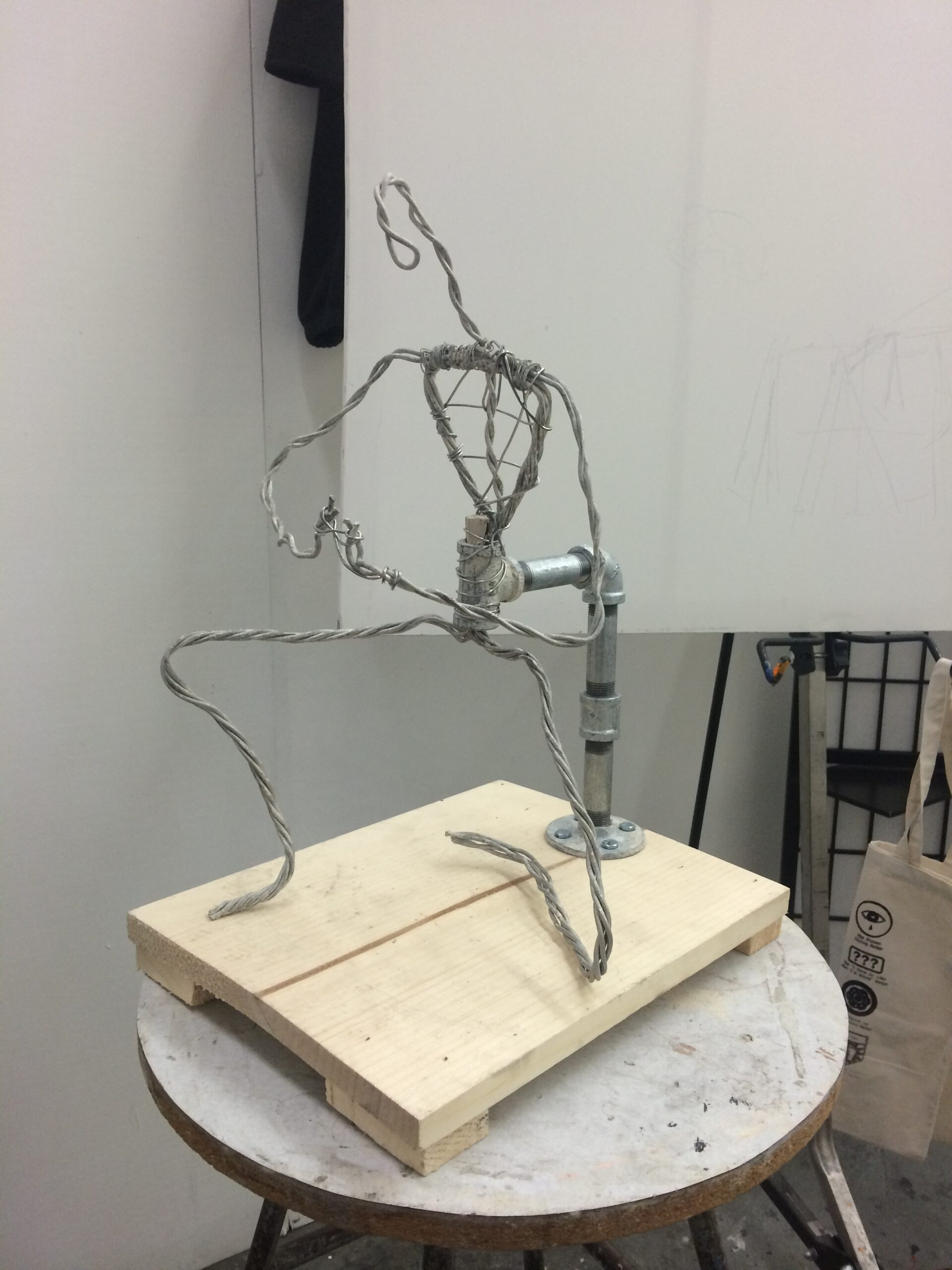 Sketching a spelunker using clay - Wire set up step.