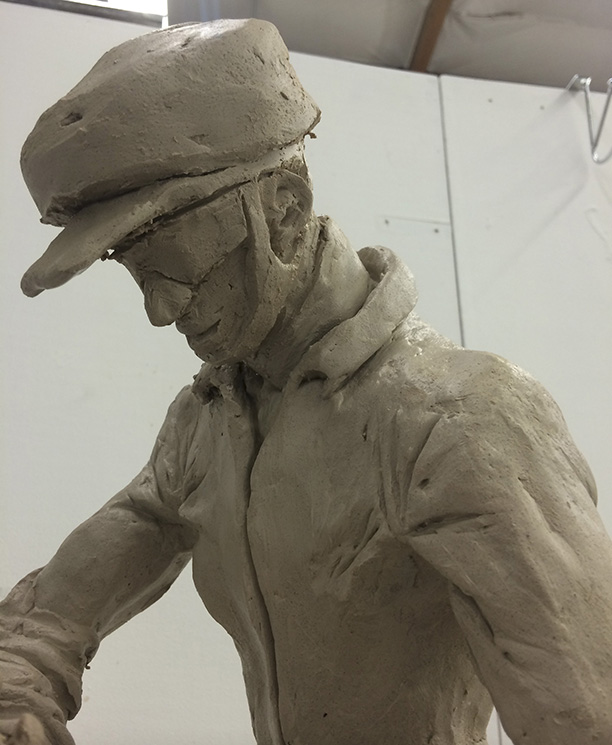 Sketching a spelunker using clay - working the face details including safety glasses.